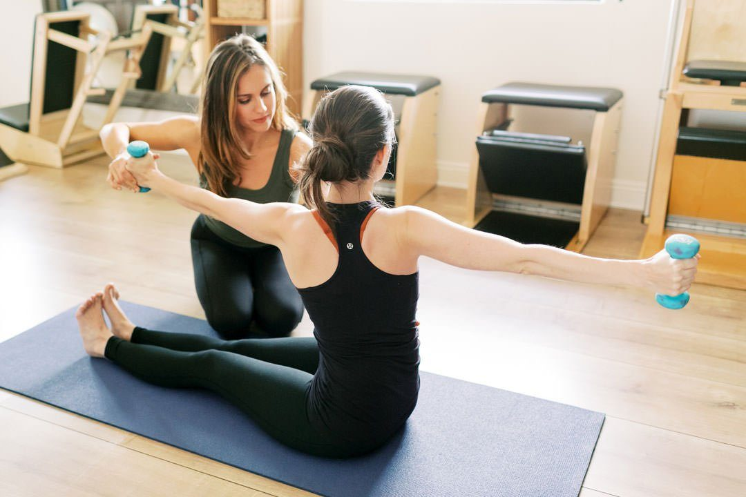 FORM Pilates LA Assisting with a twist