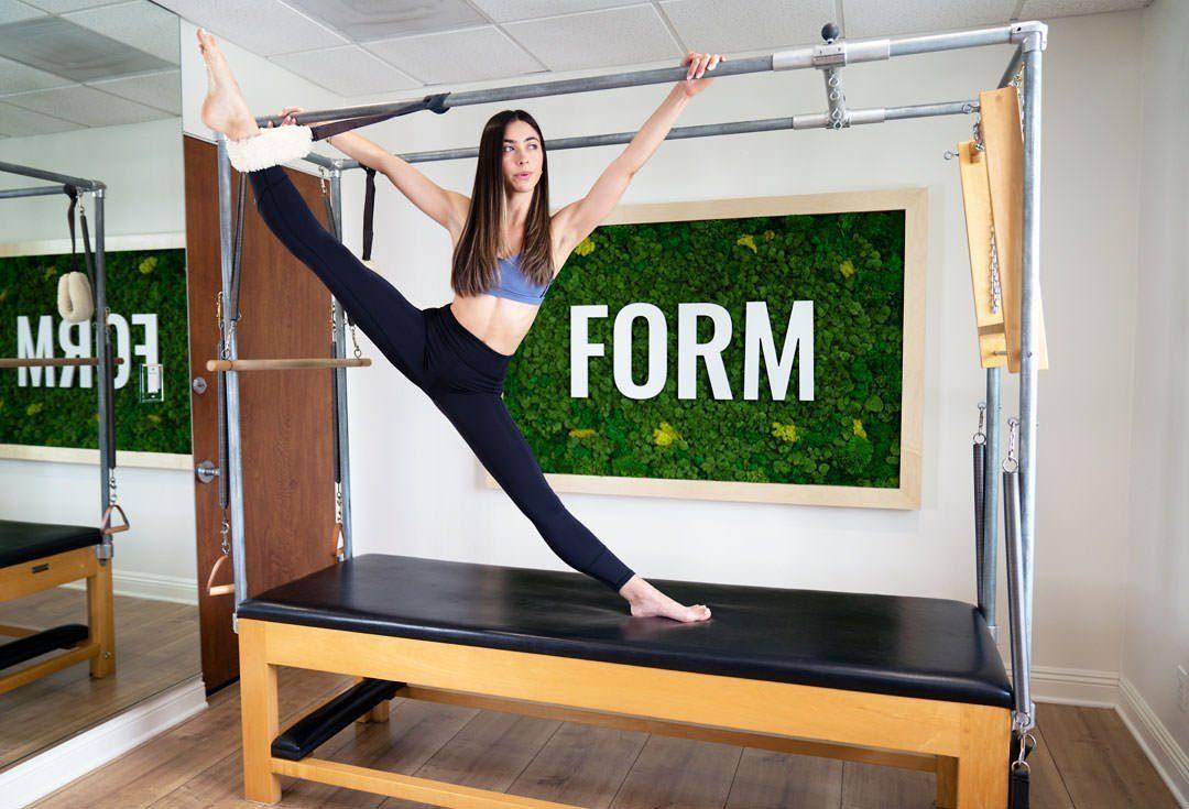 FORM Pilates LA streching on the bar